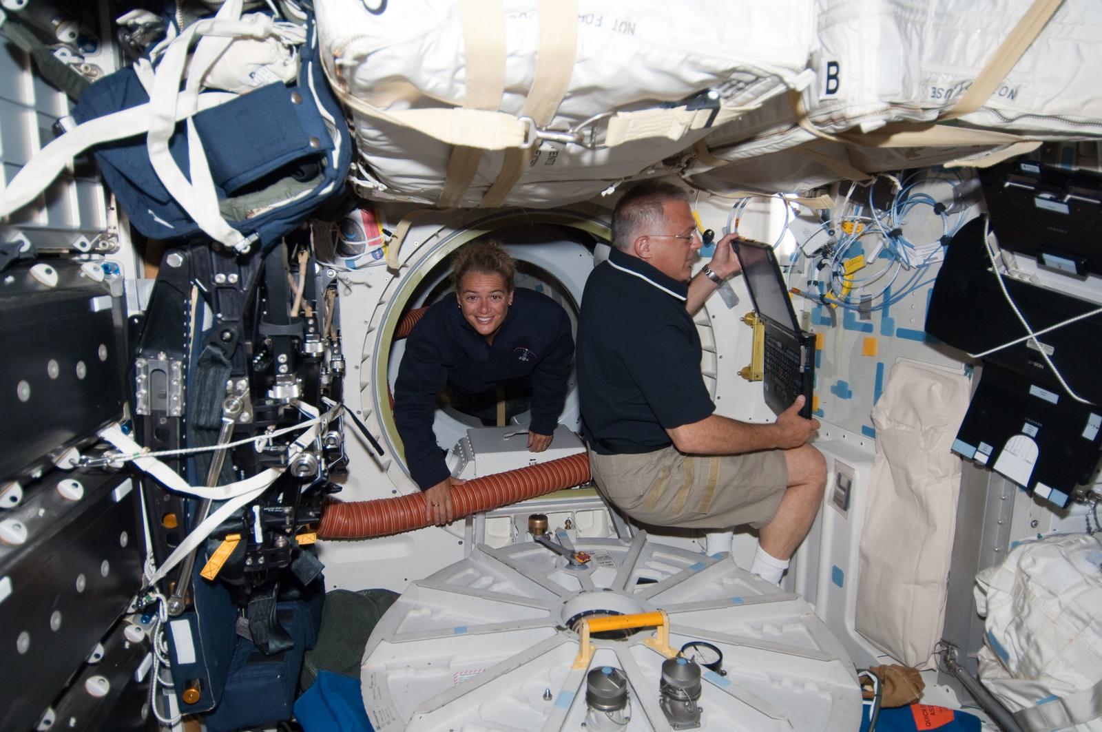 S127E006973 - STS-127 - Payette and Wolf in the MDDK during STS-127 / Expedition 20 Joint Operations