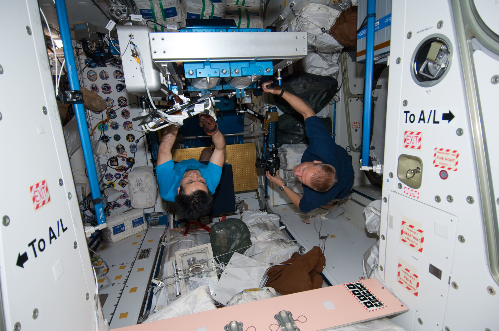 S127E007033 - STS-127 - Wakata stows the ARED in the Node 1 during STS-127 / Expedition 20 Joint Operations