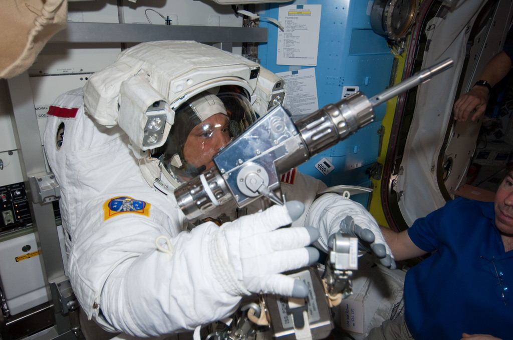 S127E007056 - STS-127 - Wolf holds EVA Tools in the A/L during STS-127 / Expedition 20 Joint Operations