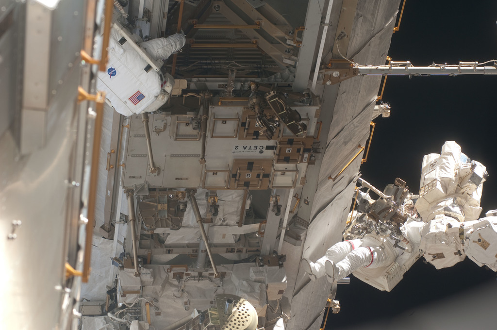 S127E007105 - STS-127 - Marshburn and Wolf during EVA-2 on STS-127 / Expedition 20 Joint Operations