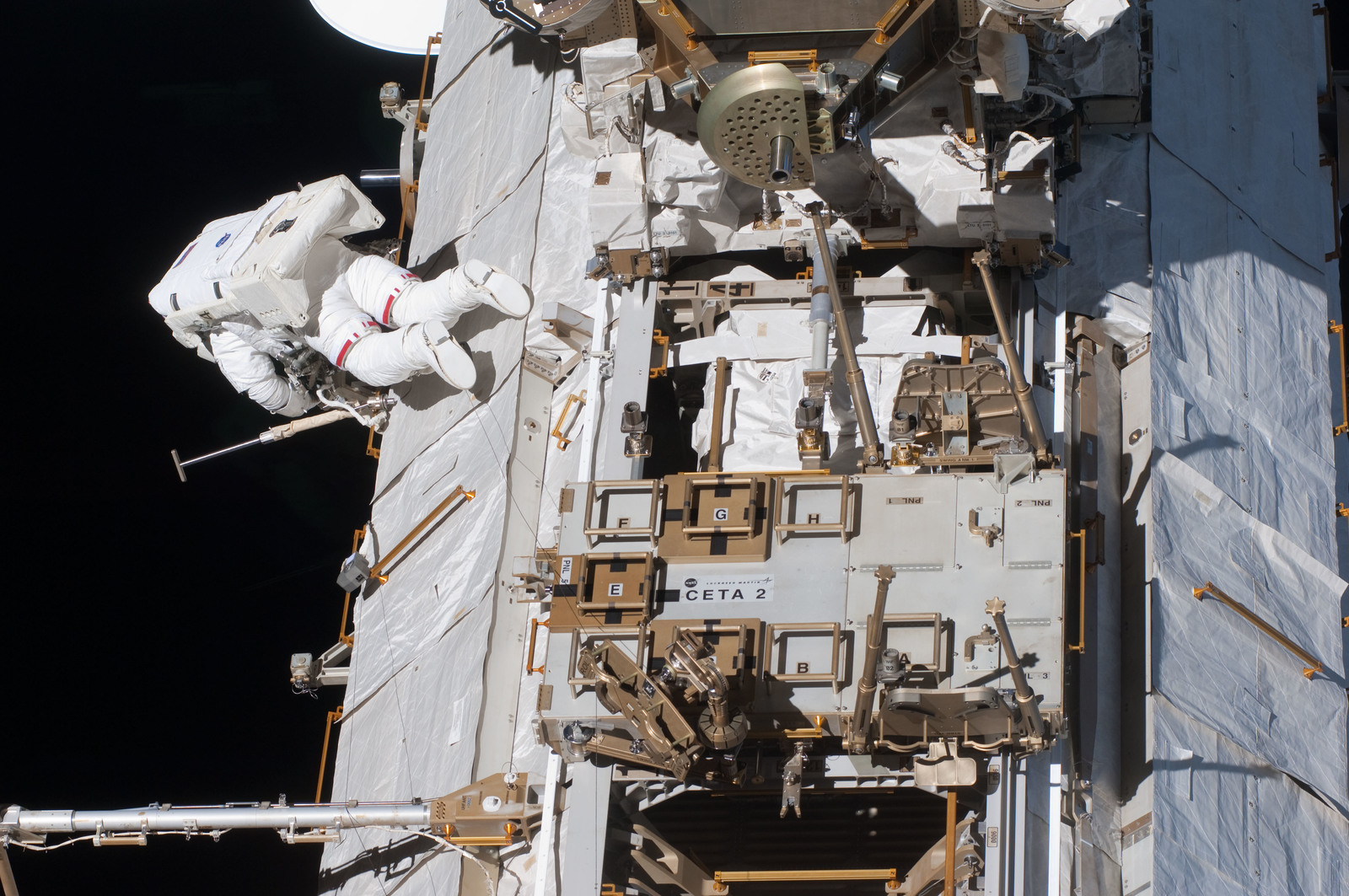S127E007229 - STS-127 - Marshburn during EVA-2 on STS-127 / Expedition 20 Joint Operations