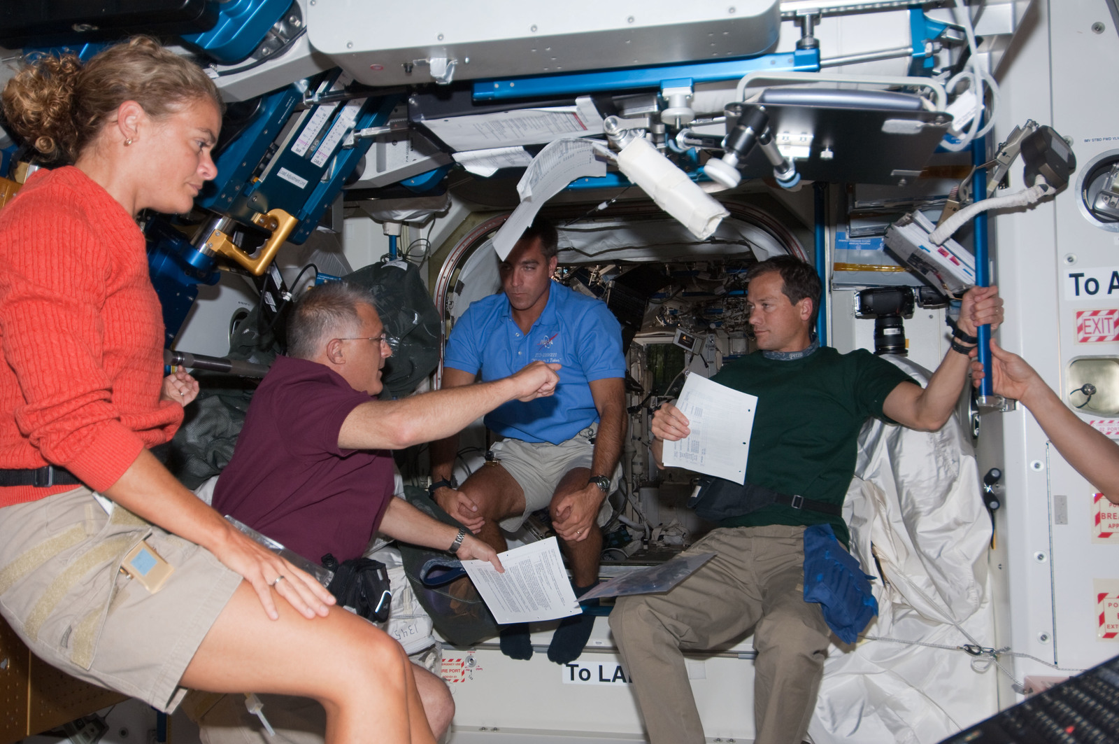 S127E007437 - STS-127 - Payette,Wolf,and Marshburn in the Node 1 during Joint Operations