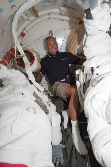 S128E006297 - STS-128 - Olivas in Shuttle Airlock with Extravehicular Mobility Units (EMU)s during STS-128
