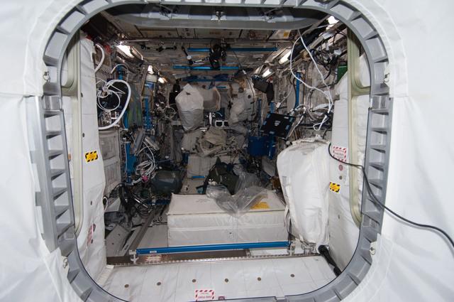 S128E007381 - STS-128 - Treasure Troll in front of EMU in European Laboratory Columbus