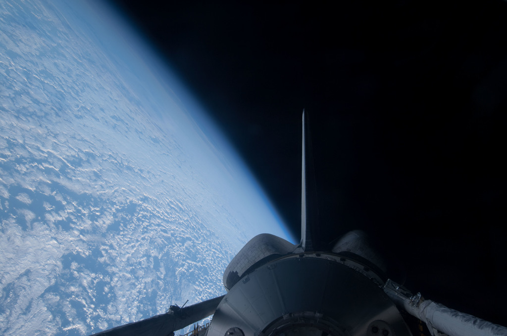 S128E011123 - STS-128 - PLB and Earth View