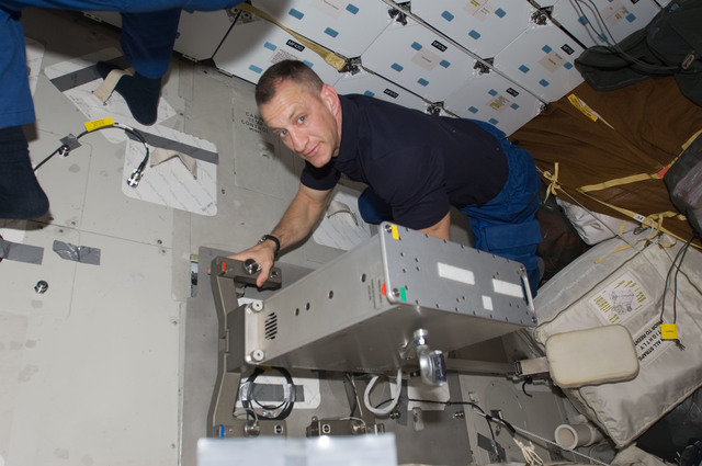 S129E006794 - STS-129 - STS-129 CDR Hobaugh works on the Bicycle Ergometer