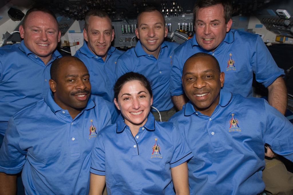 S129E010661 - STS-129 - View of the STS-129 Crew posing for a Group Portrait on the Flight Deck
