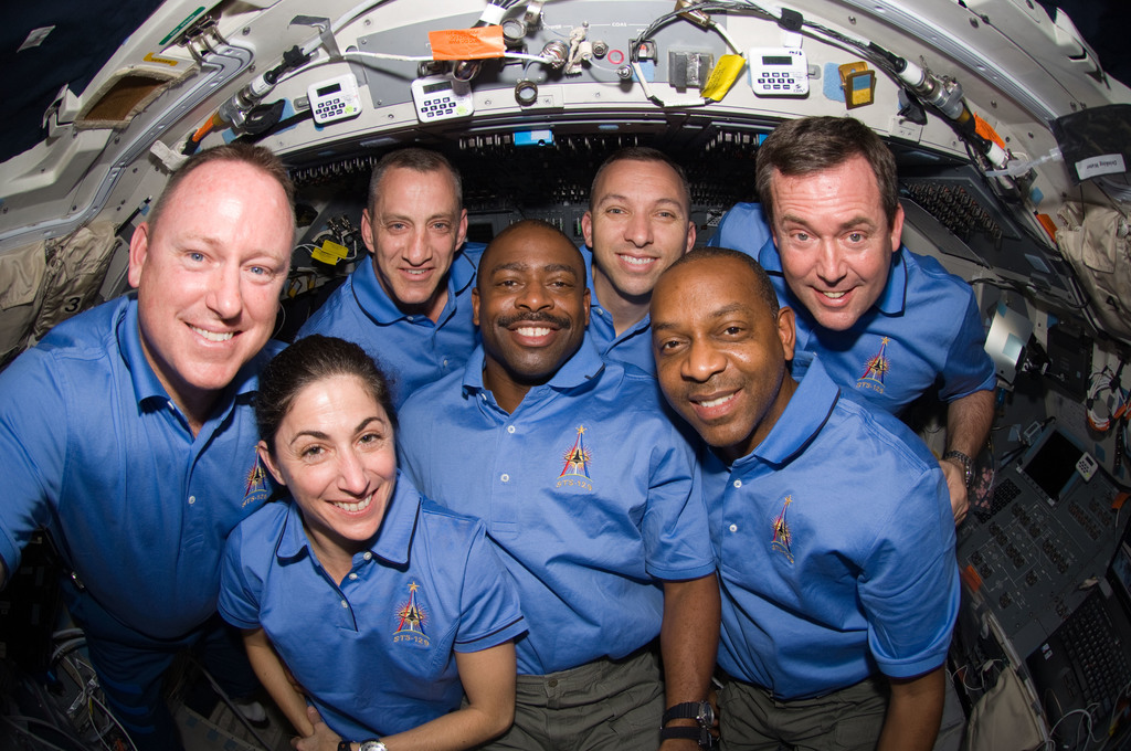 S129E010666 - STS-129 - View of the STS-129 Crew posing for a Group Portrait on the Flight Deck
