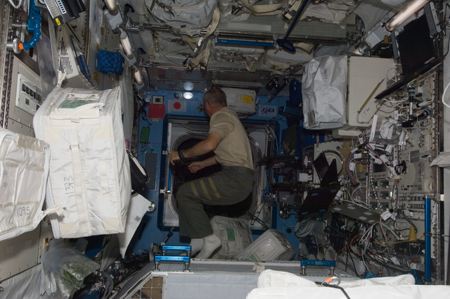 S129E011314 - STS-129 - View of Expedition 21 FE Williams in the JPM