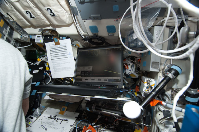 S130E006540 - STS-130 - Computer on Aft FD during Rendezvous OPS