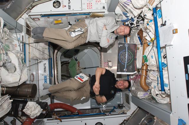 S130E006830 - STS-130 - Patrick and Behnken in Node 2