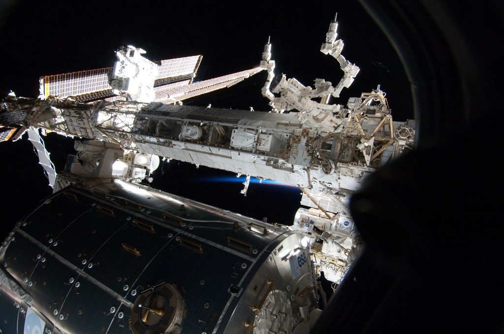 S130E007282 - STS-130 - View of Columbus and STBD Truss Segments through Shuttle Window