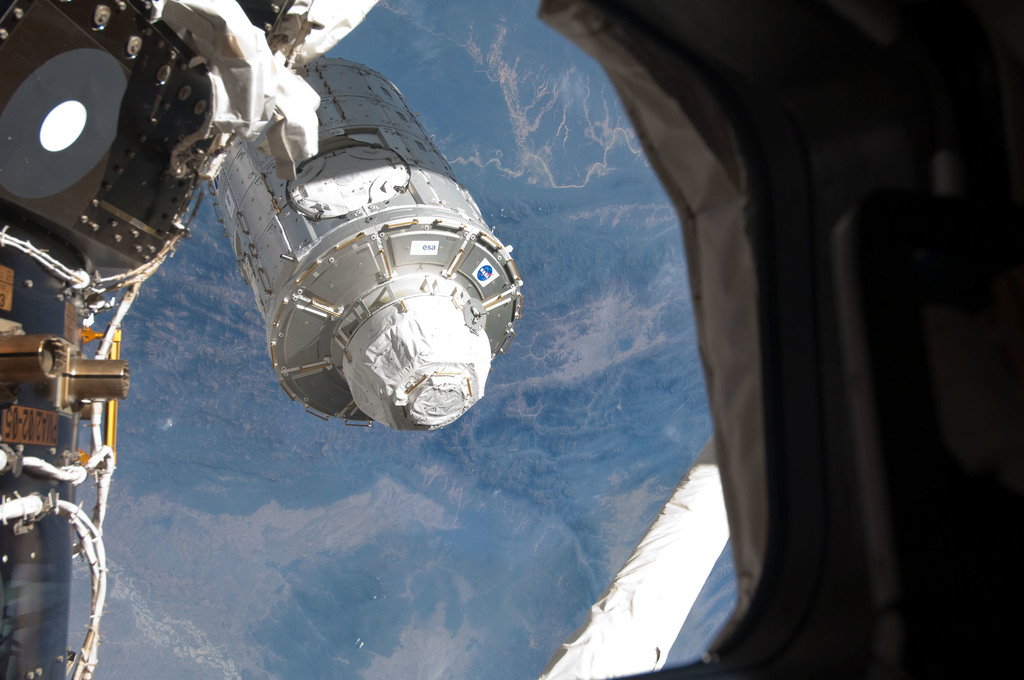 S130E007485 - STS-130 - Node 3 Transfer to ISS during EVA 1
