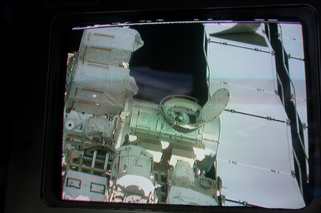 S130E009356 - STS-130 - EVA 3 on Endeavour Aft FD Monitor