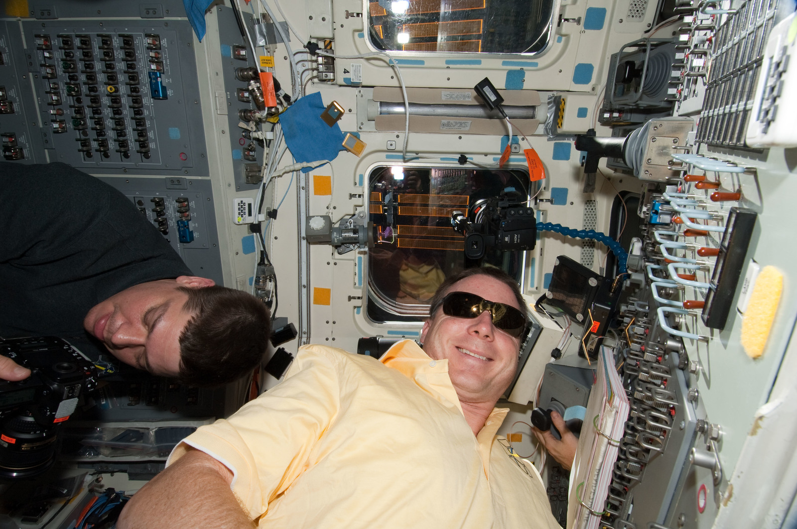 S130E012371 - STS-130 - Behnken and Virts on Aft FD during STS-130 Separation and Flyaround