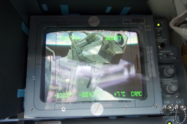 s133E006047 - STS-133 - CCTV screen