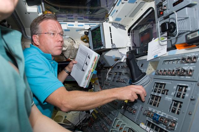 s133E006056 - STS-133 - Lindsey on aft flight deck