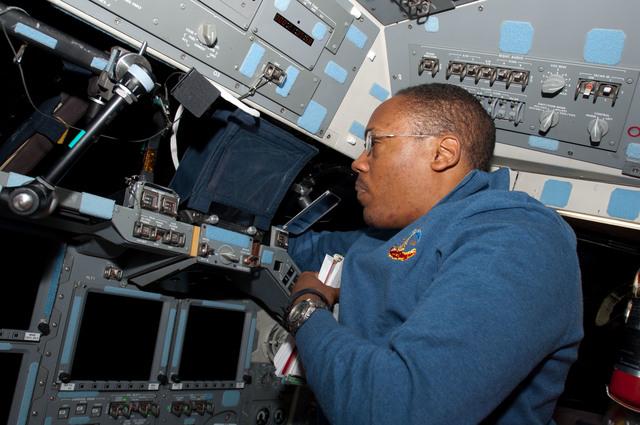 s133E006069 - STS-133 - Drew on flight deck