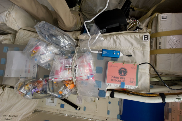 s133E006154 - STS-133 - Stowage bags on middeck
