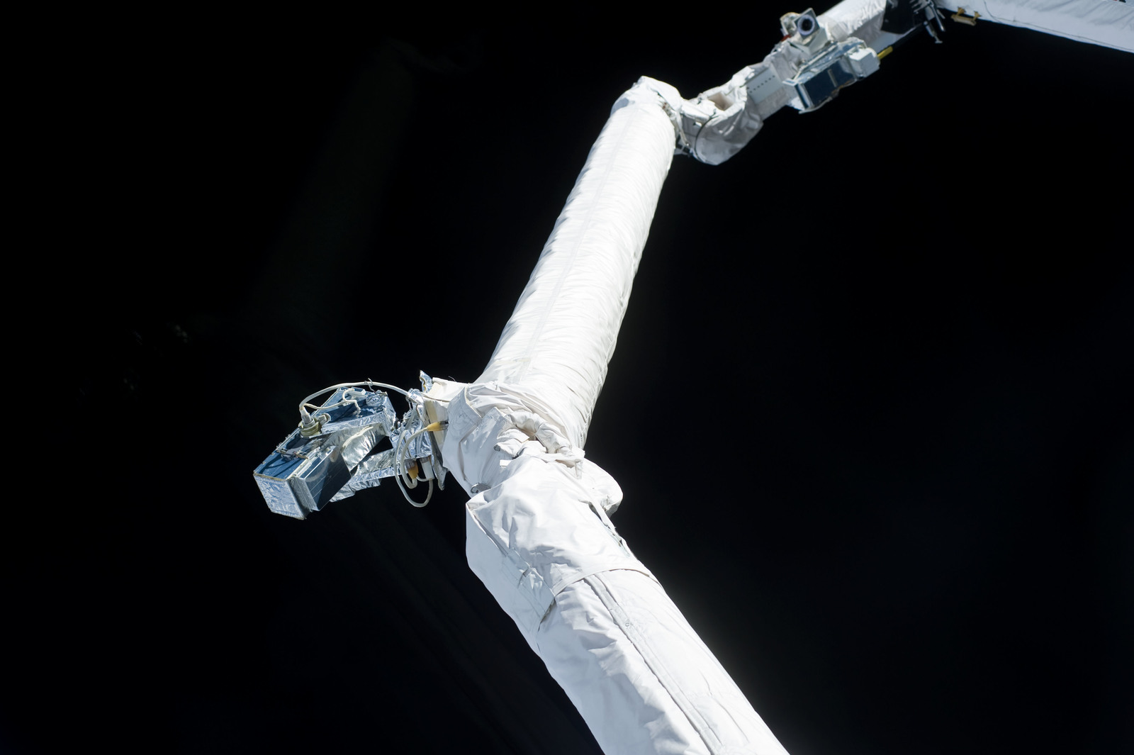 s133E006259 - STS-133 - View of camera on RMS arm