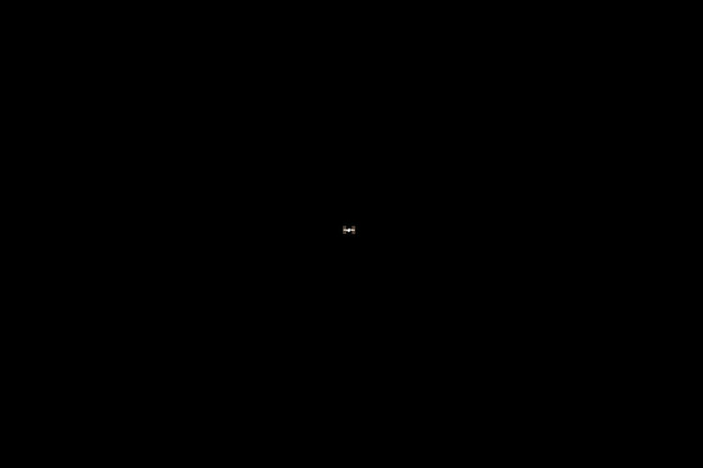 s133E006301 - STS-133 - Distant view of ISS