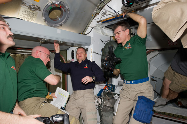 s133E006522 - STS-133 - STS-133 and Expedition 26 crew in Node 2