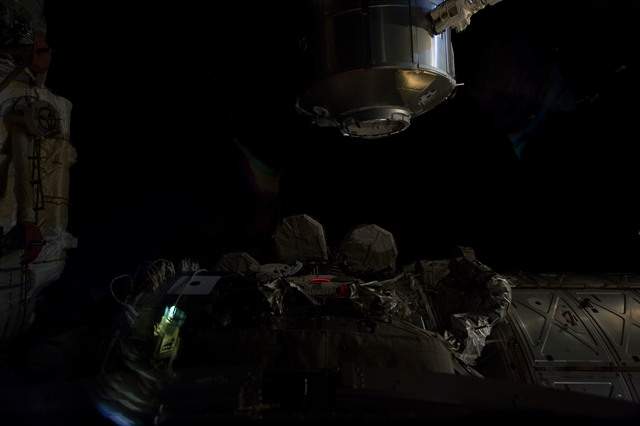 s133E007564 - STS-133 - Dark view of PMM being transferred to Node 1