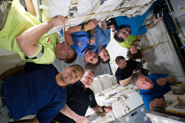s133E007916 - STS-133 - STS-133 and Expedition 26 crew enter PMM (Permanent Multipurpose Module)