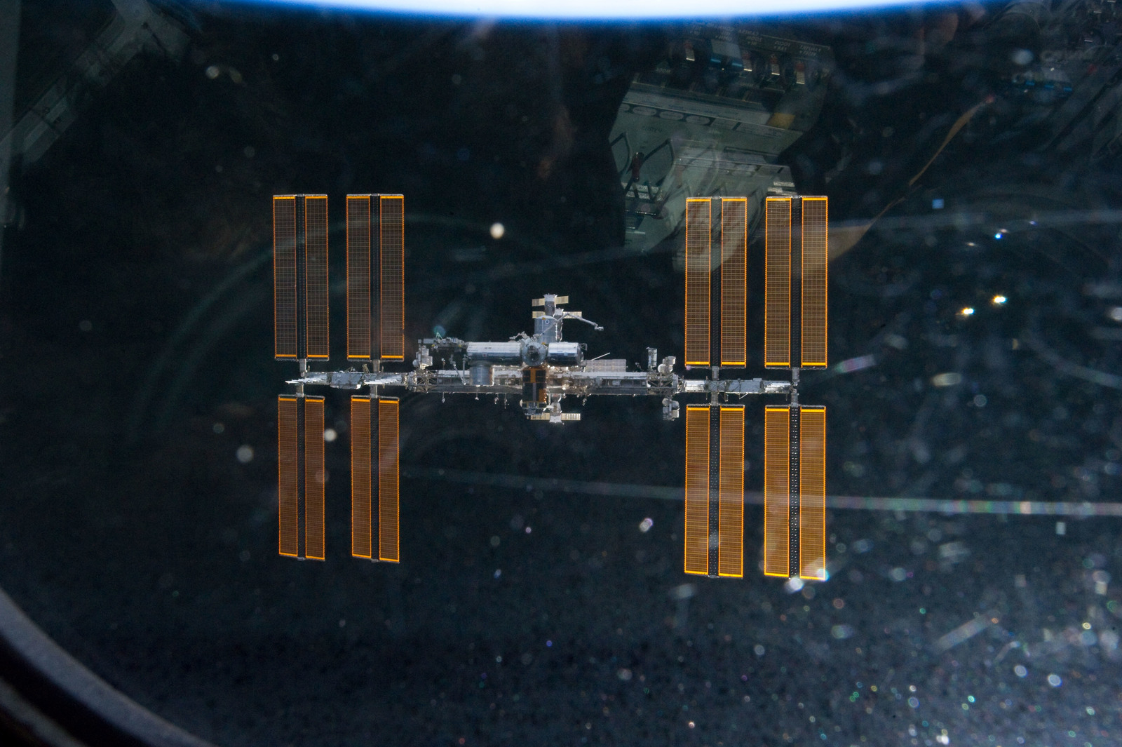 s133E011130 - STS-133 - Fly around view of ISS
