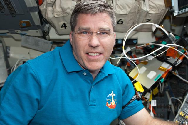 s133E011334 - STS-133 - Bowen on aft flight deck
