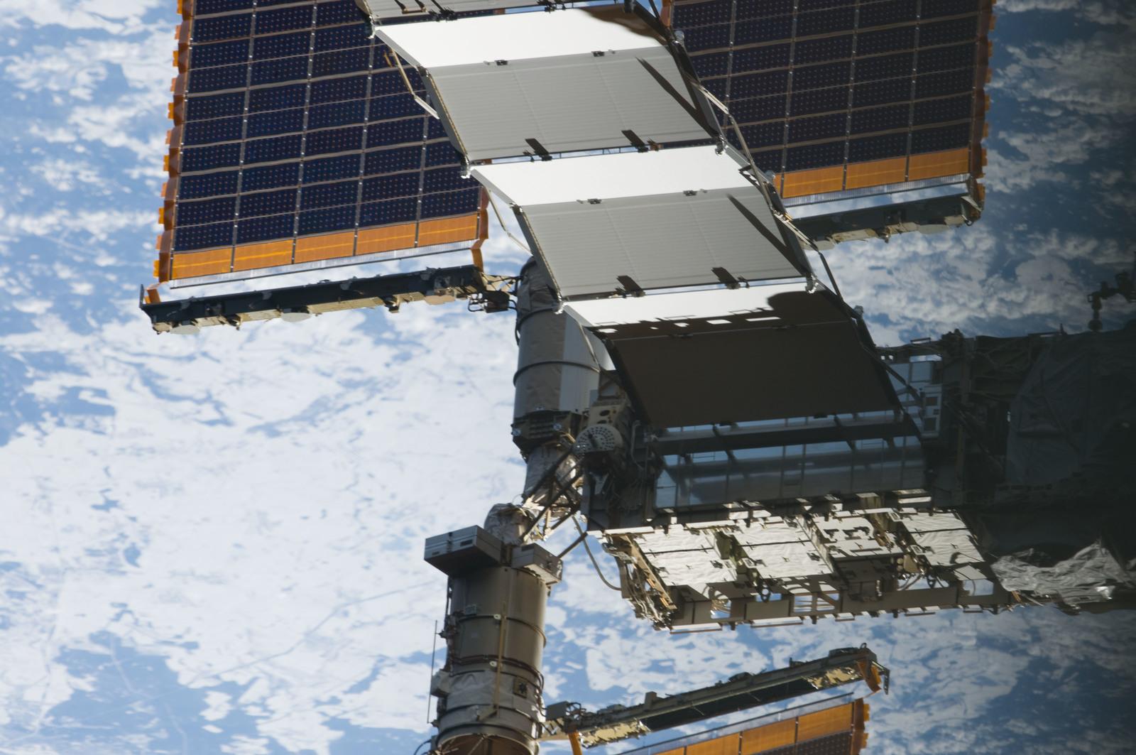 s133E011559 - STS-133 - Solar Arrays
