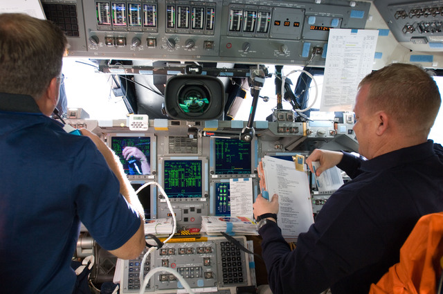 s133E012183 - STS-133 - Lindsey and Boe on forward flight deck.