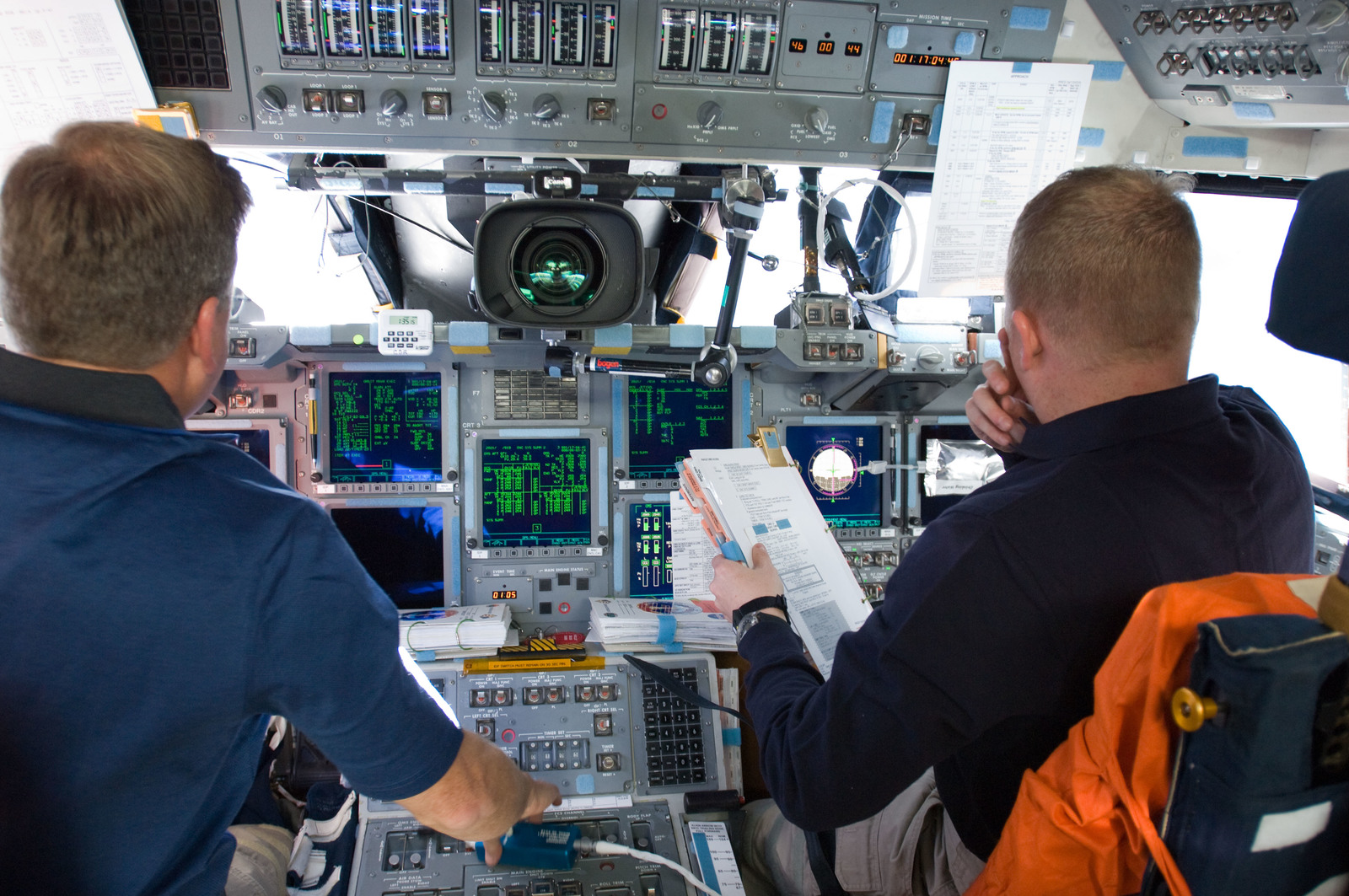 s133E012184 - STS-133 - Lindsey and Boe on forward flight deck.