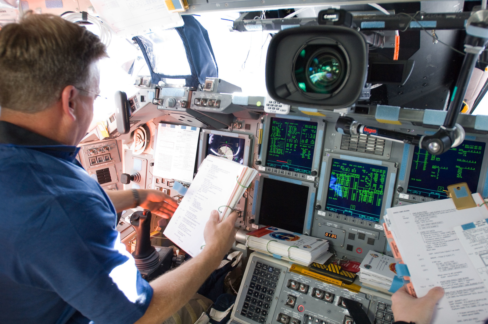 s133E012186 - STS-133 - Lindsey on forward flight deck.