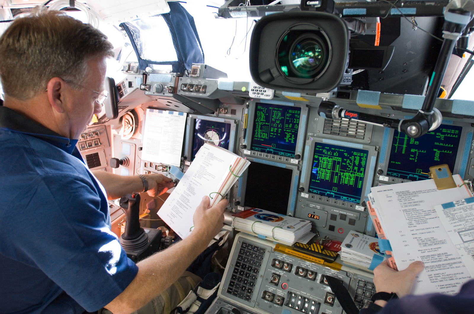 s133E012187 - STS-133 - Lindsey on forward flight deck.