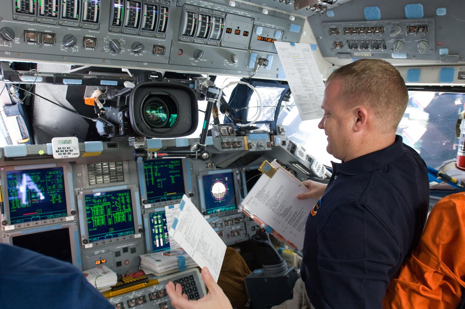 s133E012191 - STS-133 - Boe on forward flight deck.
