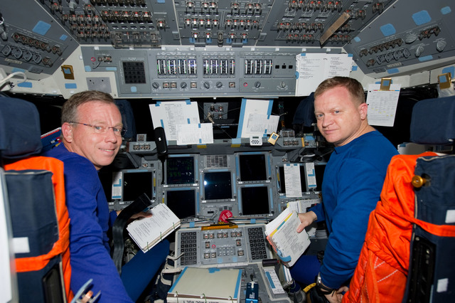 s133E013495 - STS-133 - Lindsey and Boe on forward flight deck