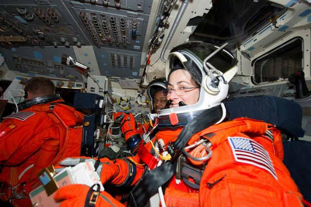 s133E013568 - STS-133 - Stott and Drew on forward flight deck