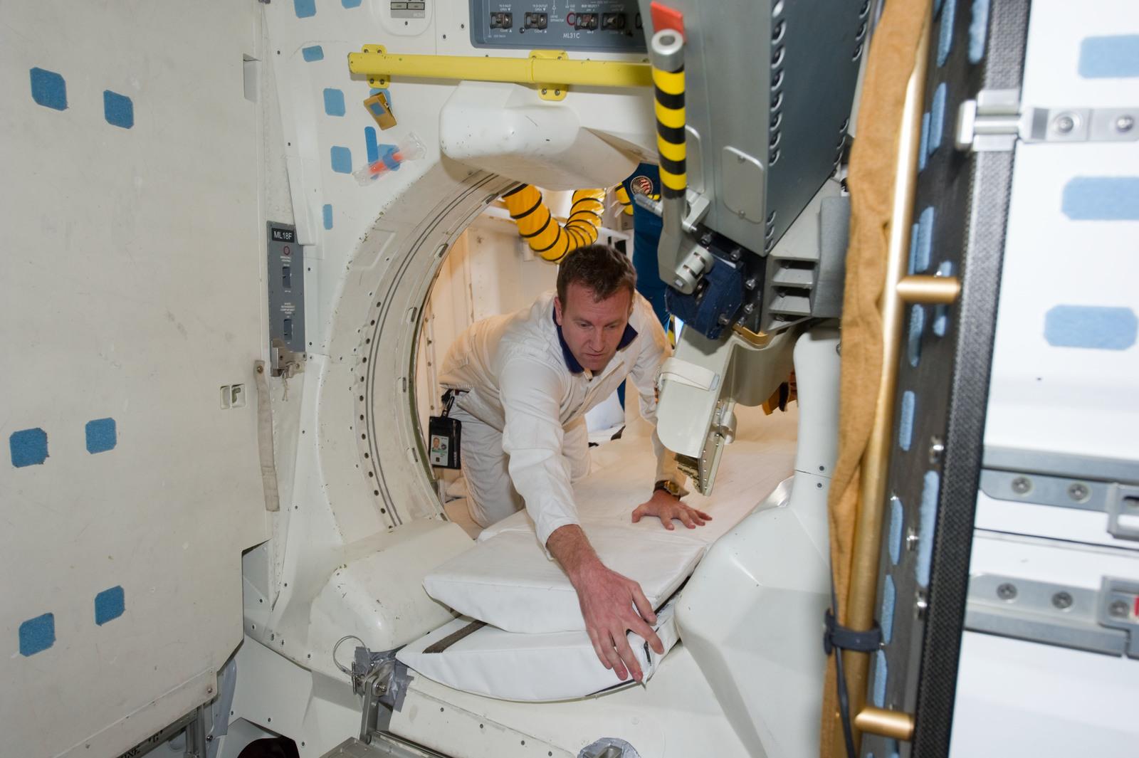s133E013586 - STS-133 - Post landing