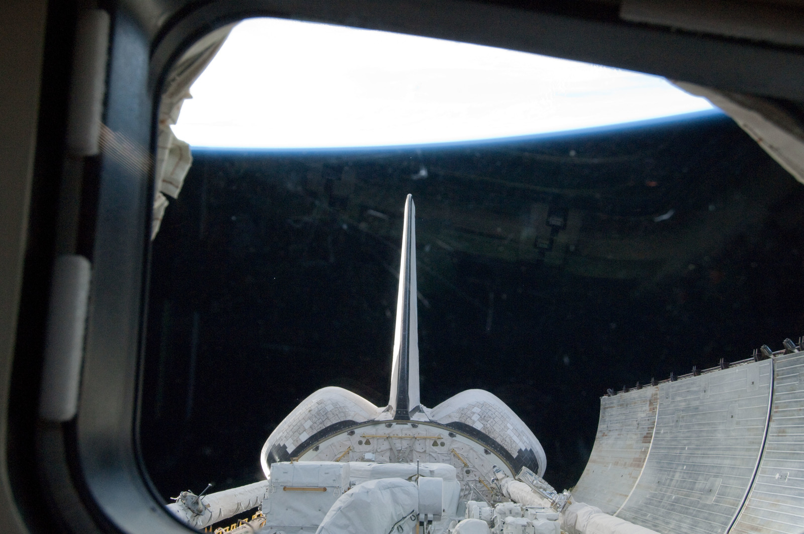S134E005318 - STS-134 - View of the Shuttle Endeavour Payload Bay, OMS Pods, and Vertical Stabilizer