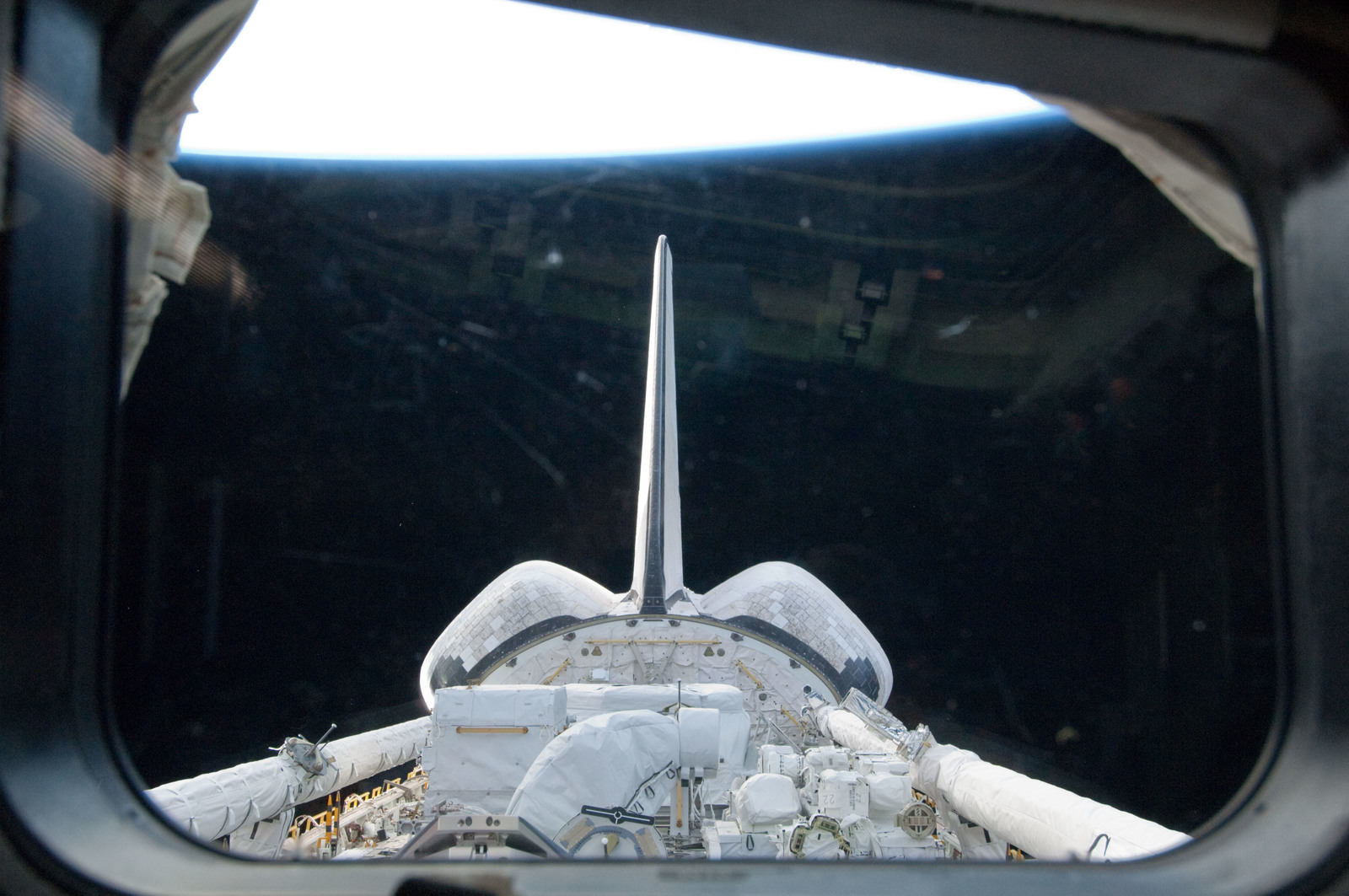 S134E005319 - STS-134 - View of the Shuttle Endeavour Payload Bay, OMS Pods, and Vertical Stabilizer