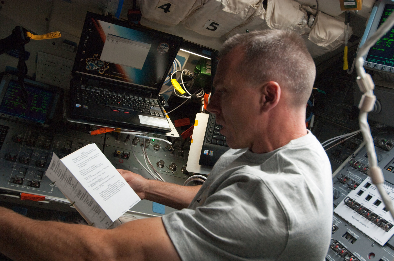 S134E005334 - STS-134 - View of STS-134 MS Feustel working on the Flight Deck