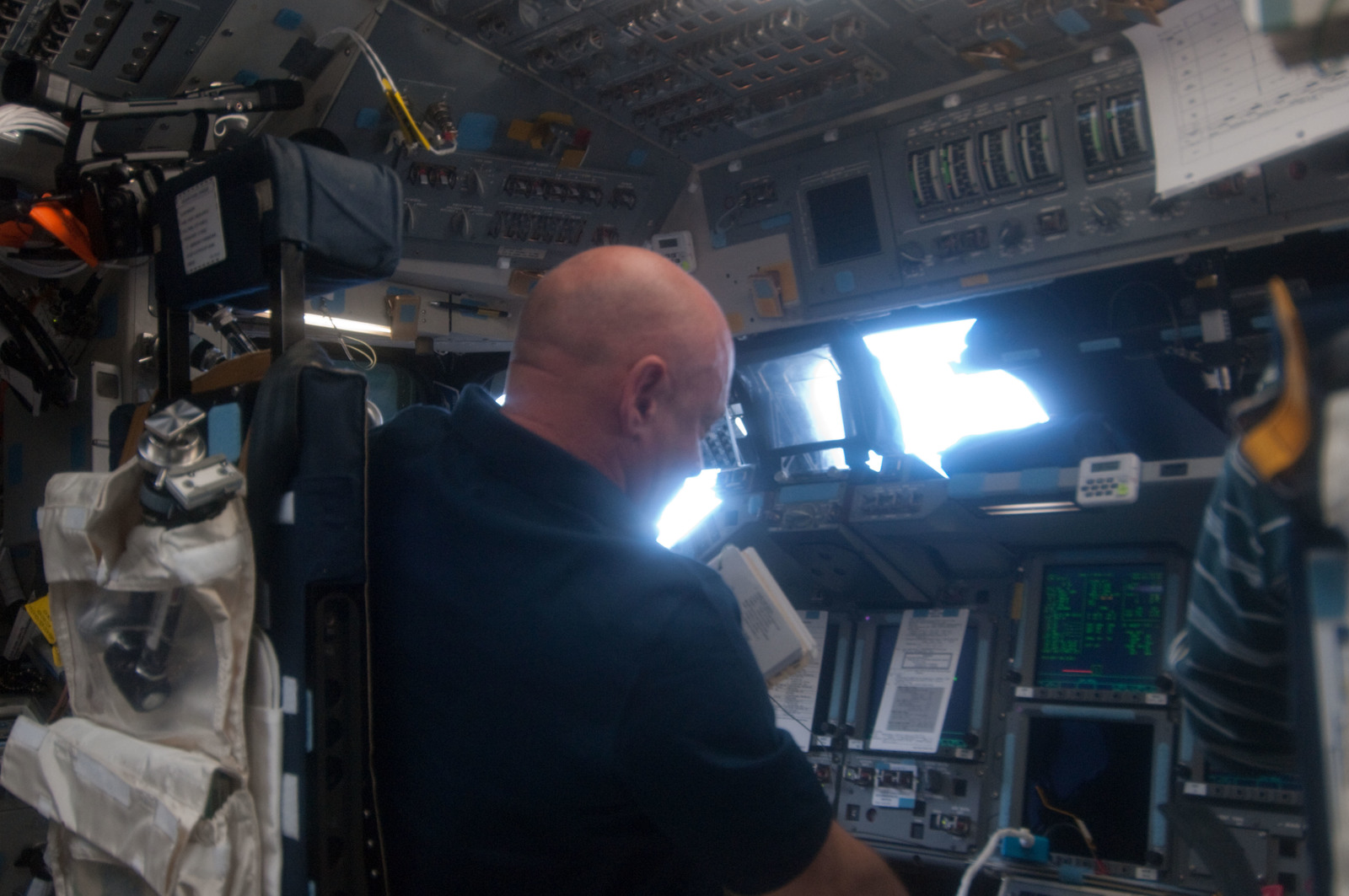 S134E005345 - STS-134 - View of STS-134 CDR Kelly working on the Flight Deck