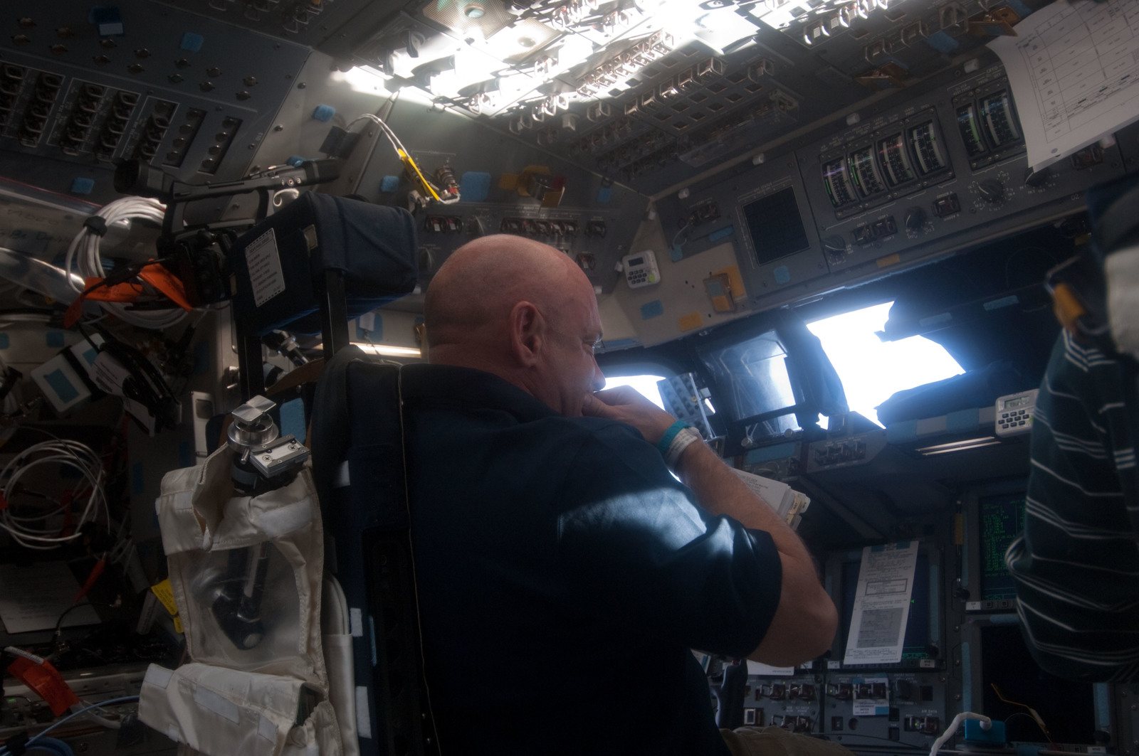 S134E005347 - STS-134 - View of STS-134 CDR Kelly working on the Flight Deck