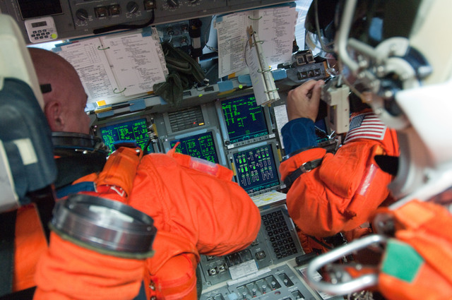 S134E005546 - STS-134 - View of STS-134 Crew Members working on the Flight Deck