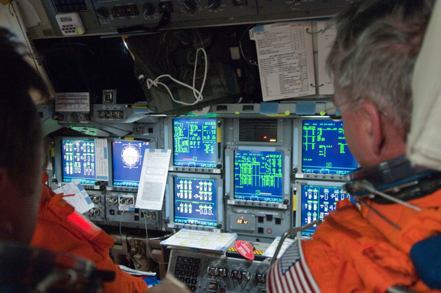 S134E005568 - STS-134 - View of STS-134 Crew Members on the Flight Deck