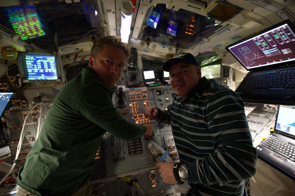 S134E006477 - STS-134 - STS-134 Crew Members working on the Flight Deck
