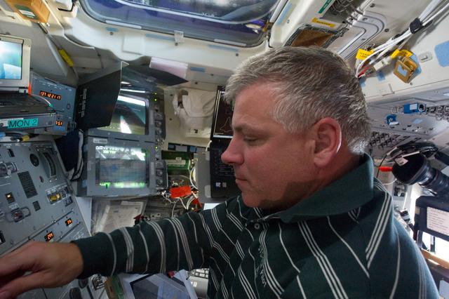 S134E006486 - STS-134 - STS-134 Pilot Johnson working on the Flight Deck