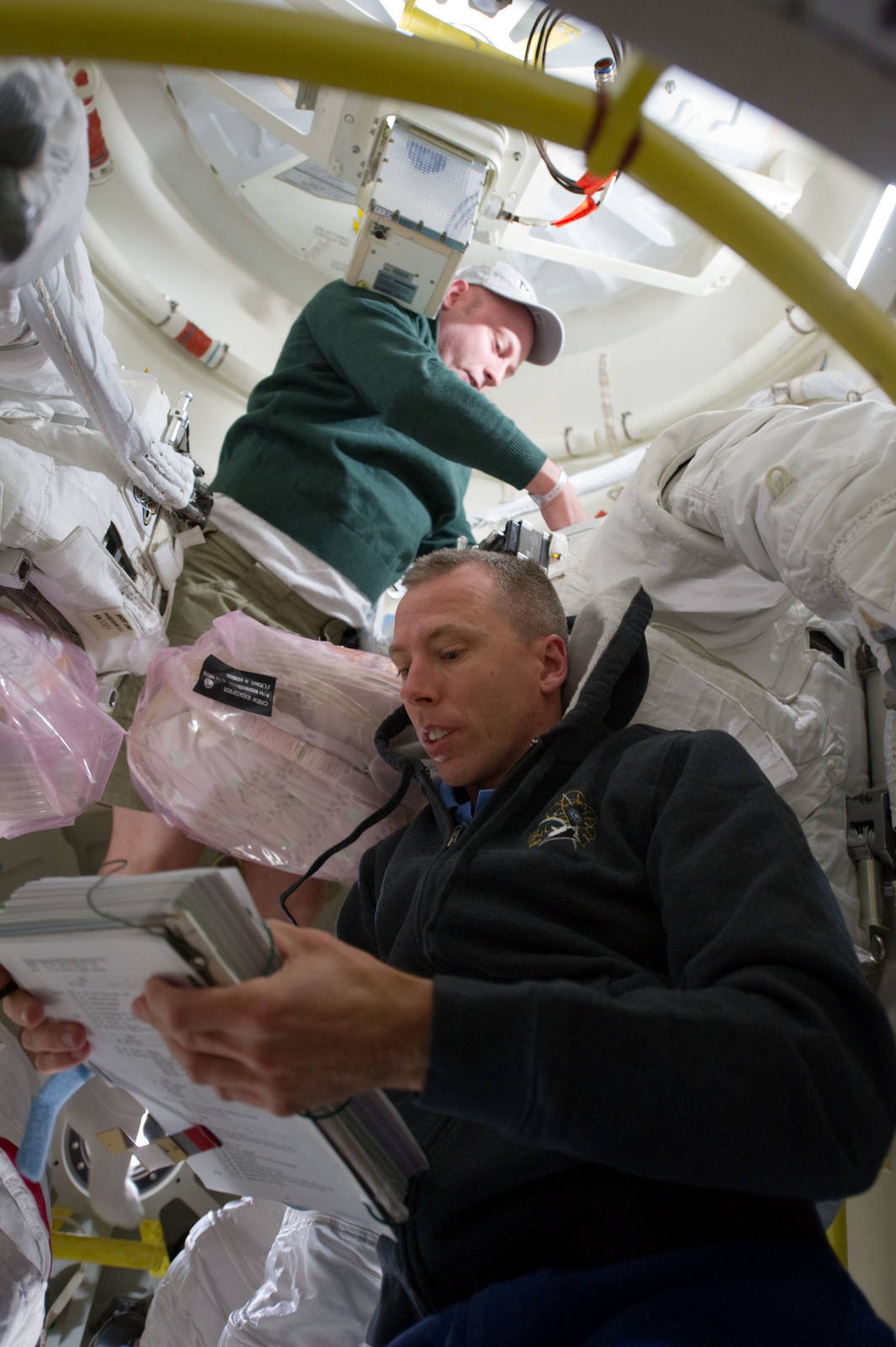 S134E006520 - STS-134 - View of STS-134 Crew Members working on the Middeck