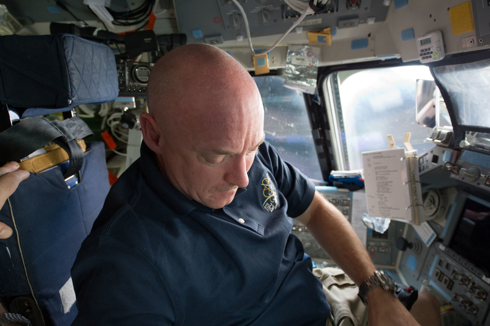 S134E006538 - STS-134 - STS-134 Commander Kelly working on the Flight Deck